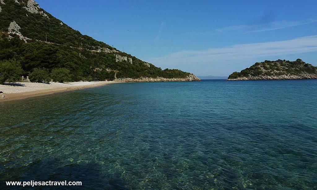 Divna beach and islet (skoj) Peljesac