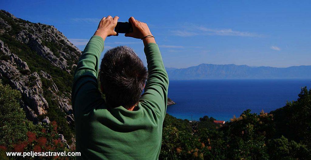 Taking photo of Divna bay
